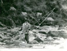 Charles, Prince of Wales fishing.