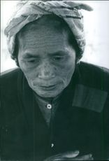 Portrait of an old woman thinking and looking something in Tokyo, Japan.