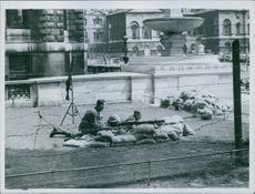 Soldiers lying on ground during wartime. 1940.
