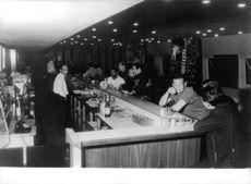 A group of man drinking in the bar in Sahara.