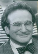 Portrait of Robin Williams, smiling, from the film