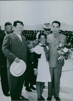 Zhou Enlai standing with other people.