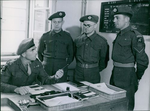 Year ?Occupation Troops go to School  Major W.A.R. Gorman, M.C., receives three new recruiters for the educational courses in his office. They are asking him questions on vocational training.