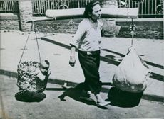 Fleeing War  Chinese woman who flees with her  just and household goods, 1942.  The Second Sino-Japanese War.