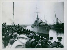 People waiting for ship to arrive.