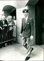Young airman Paul Davies leaves the old bailey.