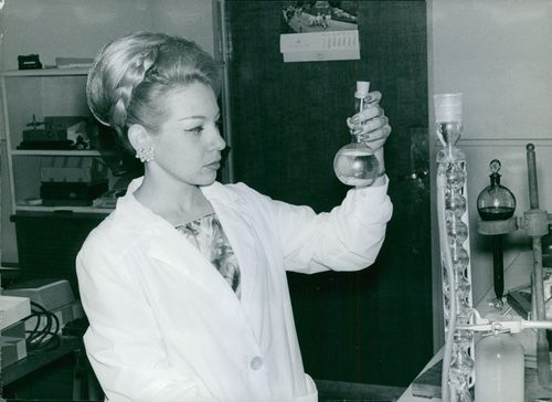 A chemist working on a lab.