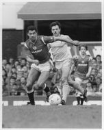 Paul McGrath and John Wark are fighting for the ball