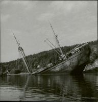 "Photo of Wrecked German cargo vessel ""Donau Oslofjorden"" along shore in 1949."