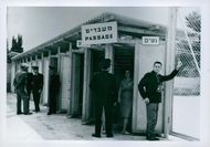 Policemen standing together and having discussion near the gate.  Taken - May 1961