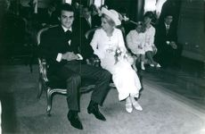 Dick Rivers sitting with his wife-to-be on their wedding day.