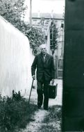 Jean David  walking with his suitcase.