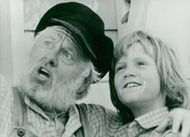 """Mickey Rooney and Sean Marshall in Walt Disney's Family Movie """"Peter and the Dragon Elliott"""""""
