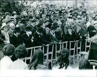 People gathered and mourning in the funeral of the victims of the murder of Girerd family. Photo taken on May 25, 1965.