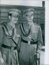 Juan Carlos standing with a man in military uniform, 1960.