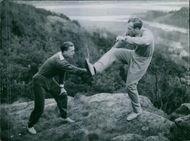 Johan Gunnar Gren and Arne Nyberg training for football on top of a mountain cliff in 1945.