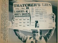 Denis Healey is holding a newspaper with the words