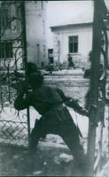 Red Army men in the process of clearing a street.