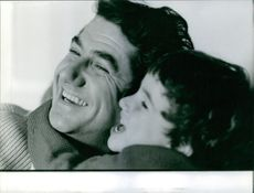 Close up of Daniel Gelin and his son. 1962