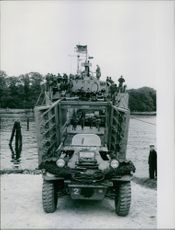 Soldiers gathered in the huge vehicle during Tyskland war, 1960.