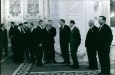 Men gathered and talking with each other.