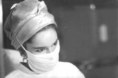 Geraldine Chaplin in white face mask.