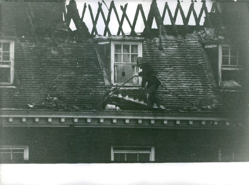 Fireman on the roof of a burned house.  - Jan 1963
