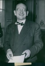 A vintage photo of Edgar Faure holding a paper in,  1952.