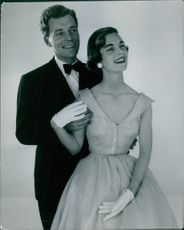 A male and female model pictured smiling.