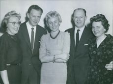 Two men and three women posing altogether, 1960.