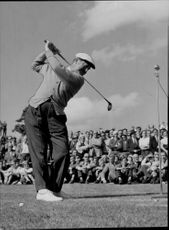 Golf player Bobby Locke in the upturn with his driver during a demonstration at the Stockholm Golf Club course at Kevinge