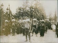 People marching in the forest during First World War.