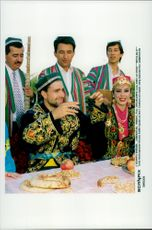 German tennis player Nicolas Kieffer wearing suits from Uzbekistan at a party in Tasjkent