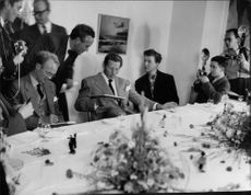 Danny Kaye in meeting with people.