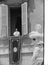 Pope Paul VI standing on window.