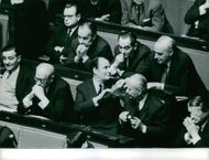 French politician Pierre Mendès France is discussing with his fellow politician in parliament