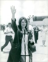 Judith Todd waving her hand to the crowd.