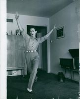 Finnish-American actress and dancer Taina Elg is dancing inside a room