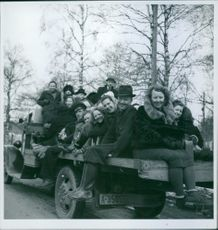 Norwegian refugees riding a truck looking at the camera, smiling, during the war, Oslo, Norway, 1940.