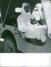 Man sitting in a vehicle and looking towards the camera.