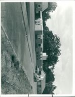 A view of the new hostel from the front, showing the single storey building flanked on either side by the two wardens' bungalows.