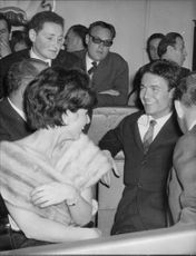 Jacques Charrier with people, smiling.