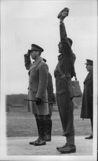 Officer heads cheer for King George VI during his visit to inspect troops