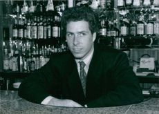 Close up of Viscount Linley in the bar, looking at something and smiling.1989