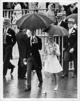 Princess Anne, holding umbrella, arrives at Roayl Ascot with David Penn, 1969.