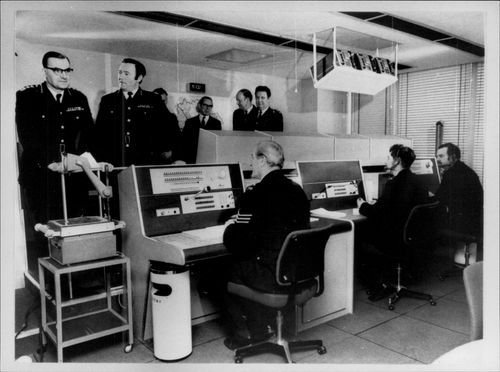 Scotland Yard interior with operators and police officers