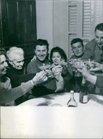 Pierre Poujade toasting drink with friends and family.