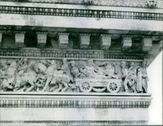 Sculptures on wall.