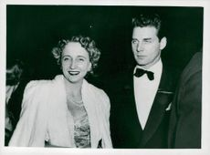 President TRUMAN's daughter Margaret with her cavalry Jean Pierre Aumont outside Ziegfield Theater