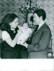 Prince Michael of Greece and his wife taking care of their baby.